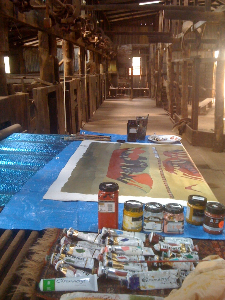 Finishing a Pilbara painting inside a cool shearing shed